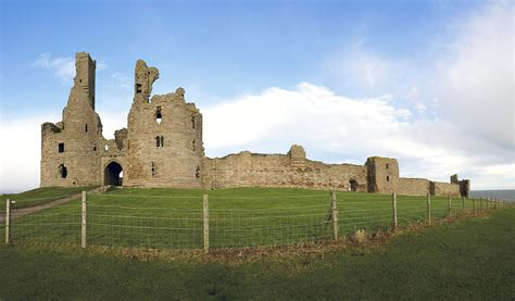 curtain wall of a castle file gatehouse and curtain wall of dunstanburgh castle