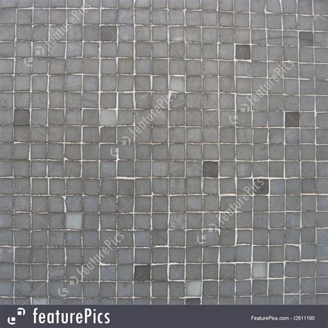 Texture: Light And Dark Gray Mosaic Tiles On A Wall