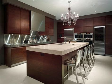 Contemporary kitchen with stainless steel backsplash and crystal