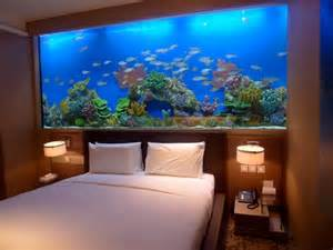 marvelous fish tank bedroom wall design with small table