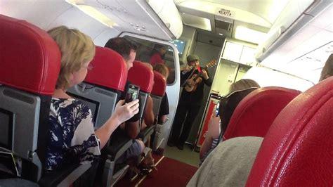 airasia x terbangi denpasar tokyo air asia flight attendant singing entertainment youtube