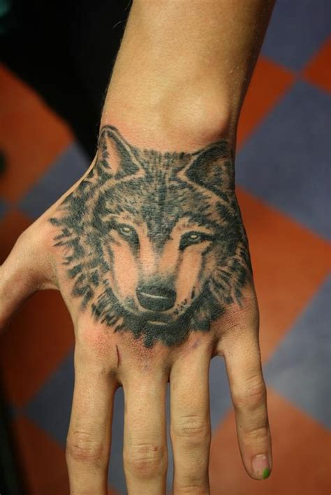 wolf hand tattoo wolf by cat johnson tattoonow