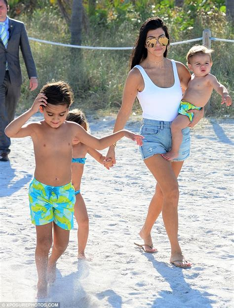 Kourtney Kardashian Displays Bodacious Behind As She