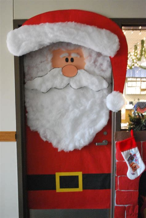 decorating doors for the new year in the form of santa claus