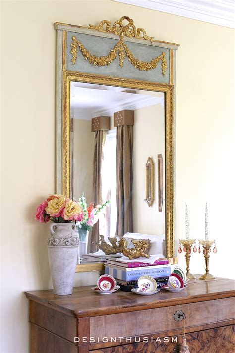 adding french country charm  gilded mirrors