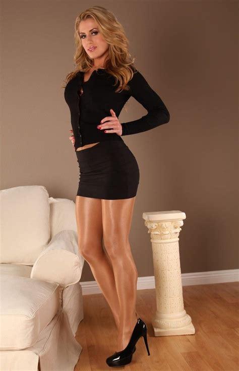 Heels Valent In wearing black mini skirt and top combo