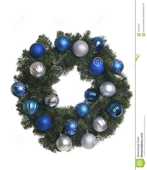white blue ornaments wreath with silver and blue ornaments on white