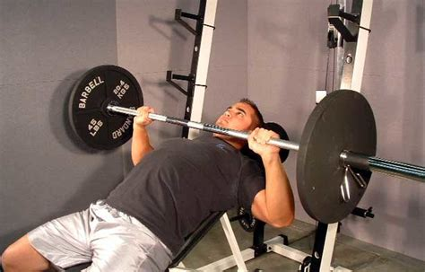 difference between barbell and dumbbell bench press targeting a stubborn chest working the pecs