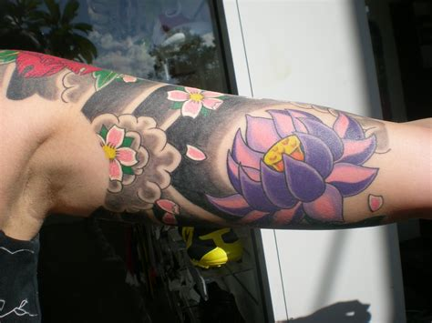 lotus finger tattoo lotus tattoos designs ideas and meaning tattoos for you