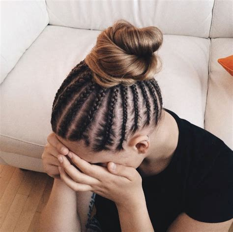 Cornrows And Loose Bun | 60 boxer braid hairstyles for your sporty side style skinner