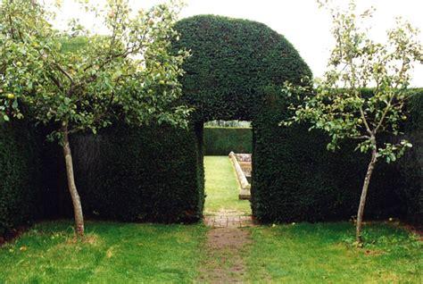 The Door In The Hedge by Door In Yew Hedge Garden Design By Barraud Garden