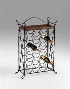 cassina wrought iron looped steel iron wine rack