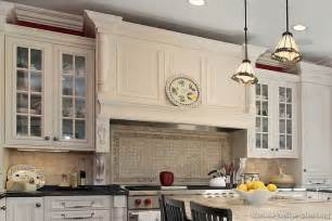Range hood basketweave backsplash and mullion glass door cabinets