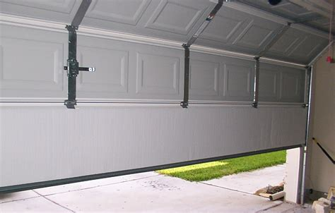 replacing a garage door replace or repair your garage door panel doormatic