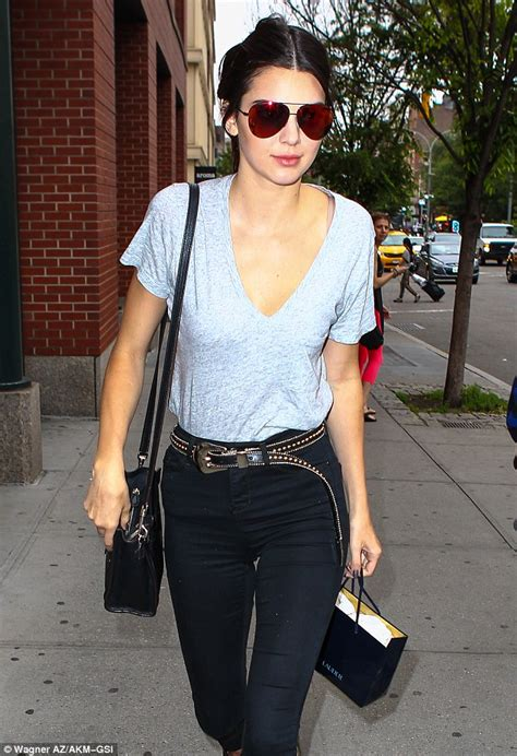kendall jenner rocks colorful aviators and a plunging t