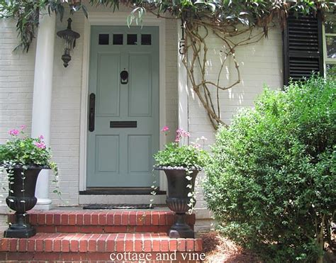 instead of blue shutters we can an updated blue front door i this color