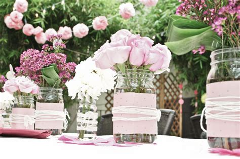 lovely light pink roses white mums and wax flowers make up bridal shower centerpieces onewed com