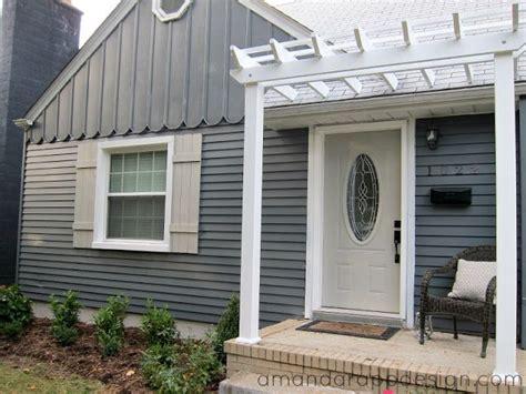 front door pergola bungalow pergola above front door slate blue charcoal painted exterior gray roof small