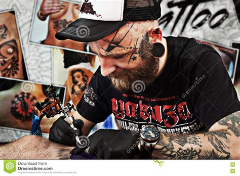 tattoo convention prague tattoo artist works on the tattoo convention editorial