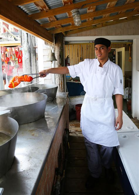 top restaurants in bar harbor maine cook holding boiled lobster in stewman s restaurant in