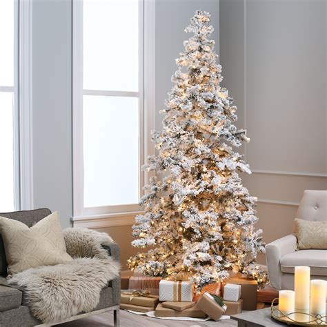 heavy flocked layered spruce pre lit christmas tree by