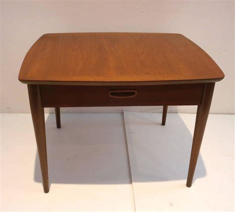 1950s danish modern end table in walnut with drawer for