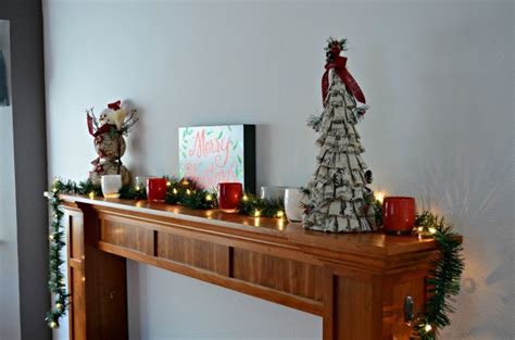 lighted garland for mantle easy christmas mantle decor simply darr ling