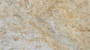 New gold antique granite is a white and gold natural stone