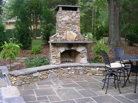 fireplace with bench and bluestone patio