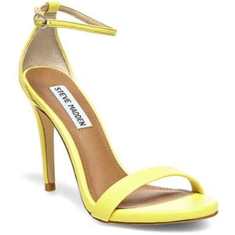 34 steve madden shoes listing steve madden yellow strappy heels 20 from cynthia s