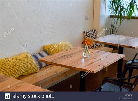 Bench Seating At A Coffee Shop Restaurant With Small Cafe
