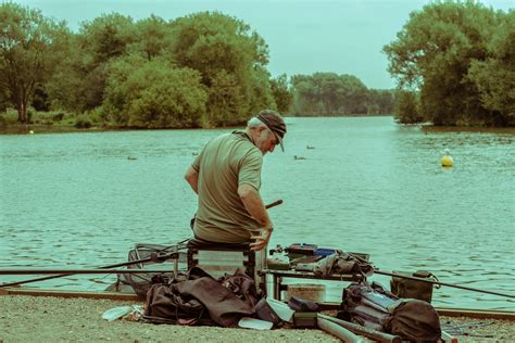 boating and outdoors free images man water lake fisherman leisure trees