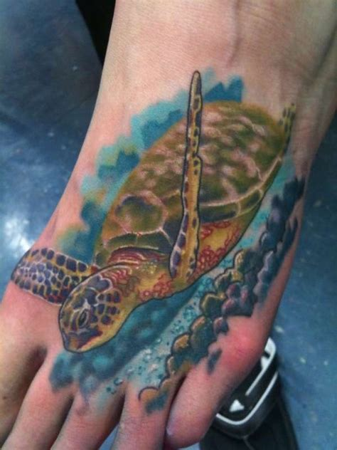 wonderful floating sea turtle tattoo on foot