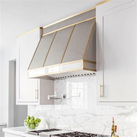 small white kitchen with steel hood stainless steel kitchen hood with brass trim