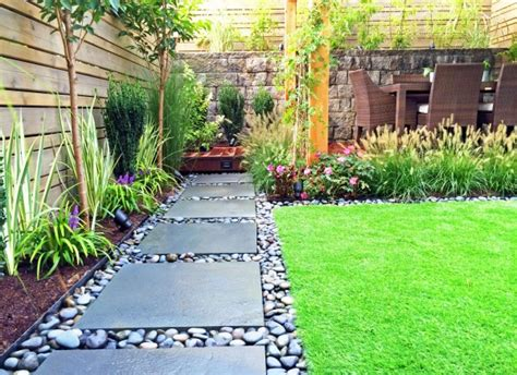 landscaping ideas for large backyards like the large paver and river rock for the low deck