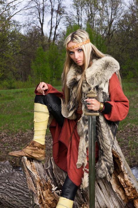 viking girl  sword   wood stock photo image