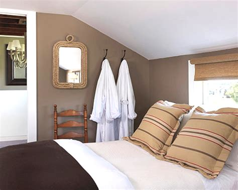 brown walls in bedroom cozy nautical cottage rooms in brown completely coastal