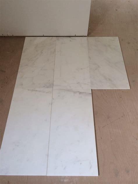 master ensuite tile carrara marble or calcutta porcelain can t deci