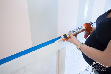 Caulking Wainscoting by Diy Wainscoting With Textured Wallpaper
