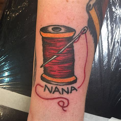 tattoo traditional needle red spool thread with needle tattoo on foot