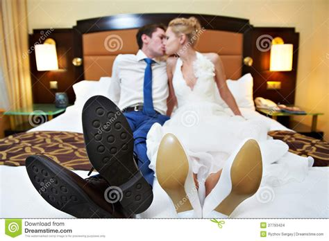 bedroom love kiss romantic kiss happy bride and groom in bedroom stock photo