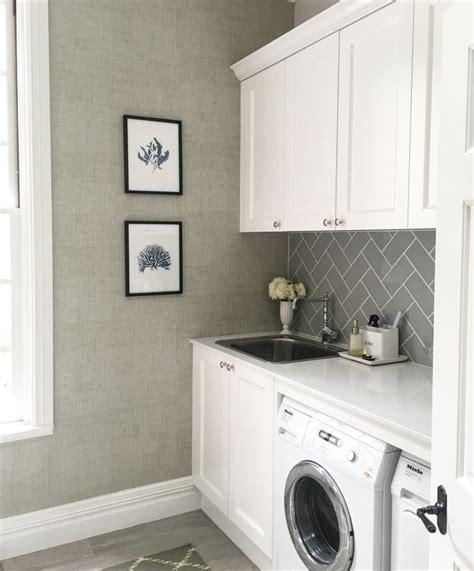 laundry room floor cabinets laundry thibaut raffia wallpaper grey subway tiles