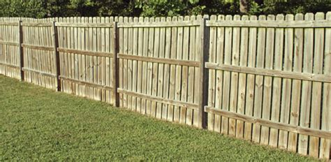 How Much To Put Up A Fence In Backyard by Putting Up Wood Fence Fences