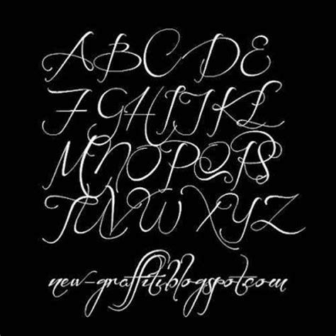 cursive graffiti writing alphabet before the rain font