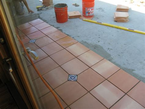 laying saltillo terra cotta tiles outdoors