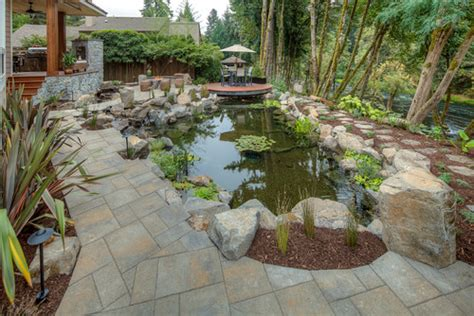 koi pond surrounded by tiger wood decks and gorgeous river view