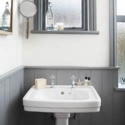 white and grey bathroom with traditional basin decorating features wallpaper top part