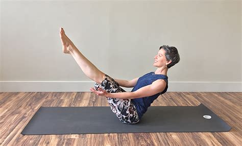 boat pose holding toes 5 yoga practices for balancing the solar plexus chakra