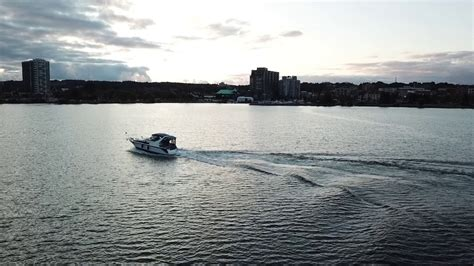 speed boat waterfront high flying friday speed boat chasing with the dji
