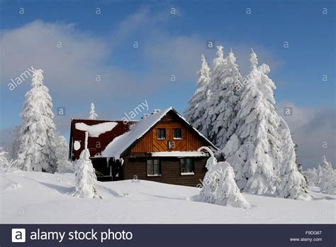 winter cottage wooden cottage in winter landscape stock photo